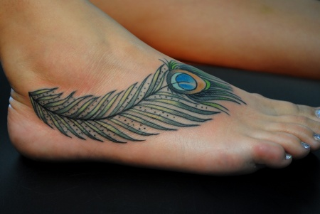 peacock feather tattoo on foot Peacock Feather Tattoo for Royal Character