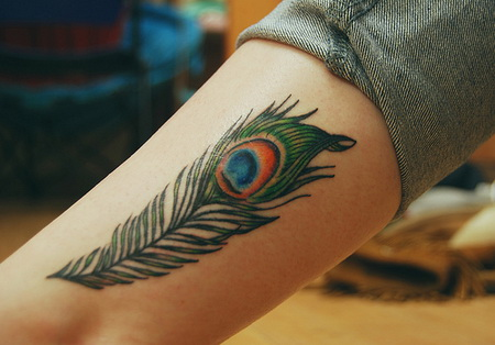 peacock feather tattoo on side Peacock Feather Tattoo for Royal Character