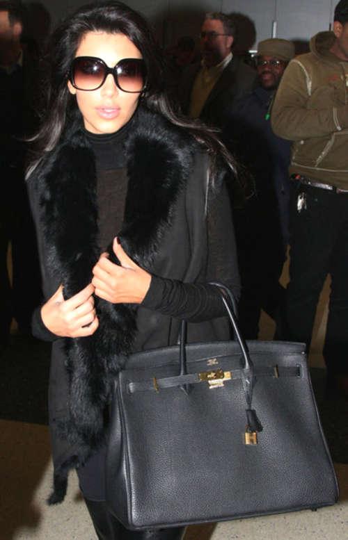 kim kardashian black birkin bag fashion show on